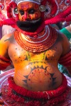 After the dance people wait to touch the feet of Theyyam and get blessings
