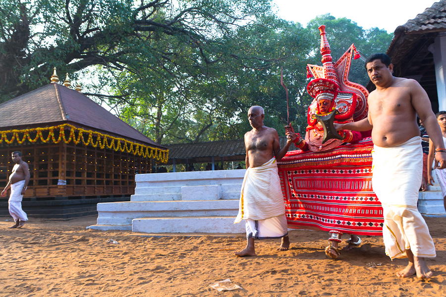 a  theyyam circling the temple